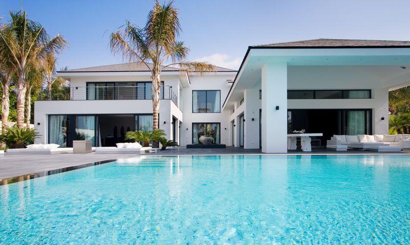 stunning modern property in los monteros featured in luxury portfolio magazine. Black Bedroom Furniture Sets. Home Design Ideas
