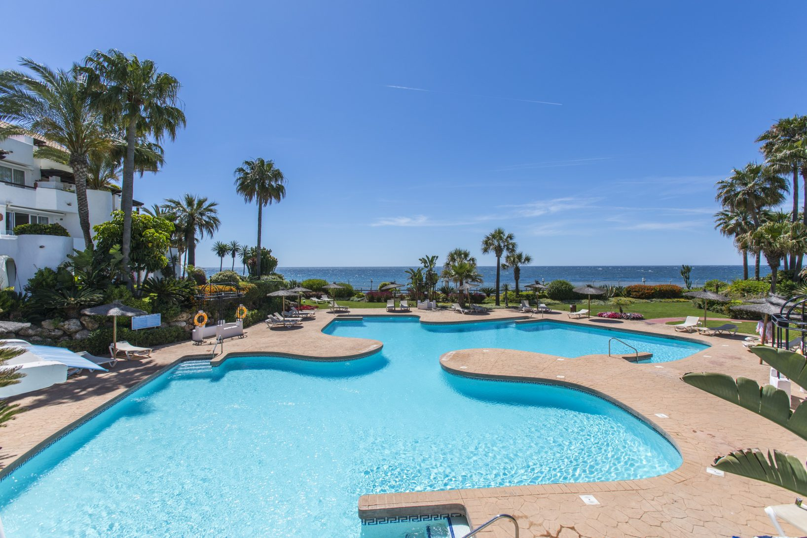 Property of the month: Frontline beach apartment in gated and secure complex next to Puerto Banus